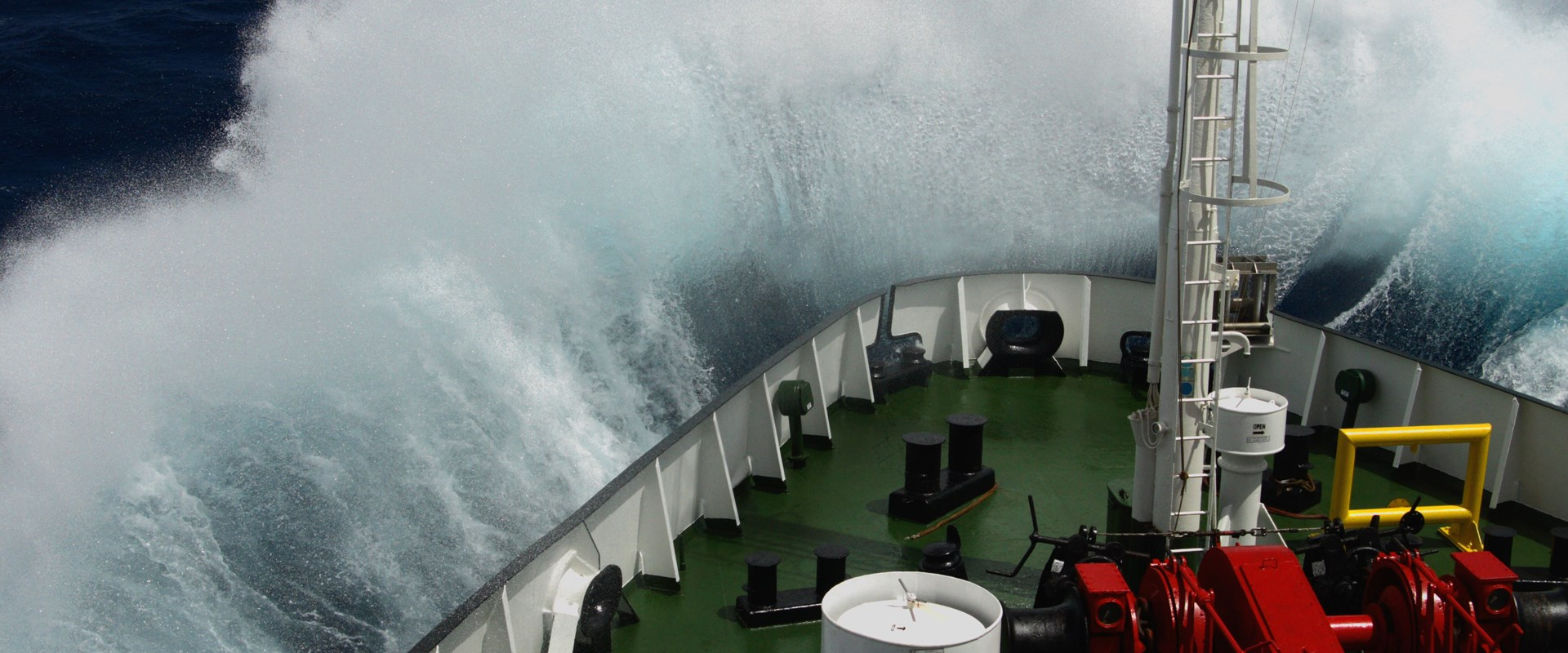 Big wave rolling over the snout of the ship - Image