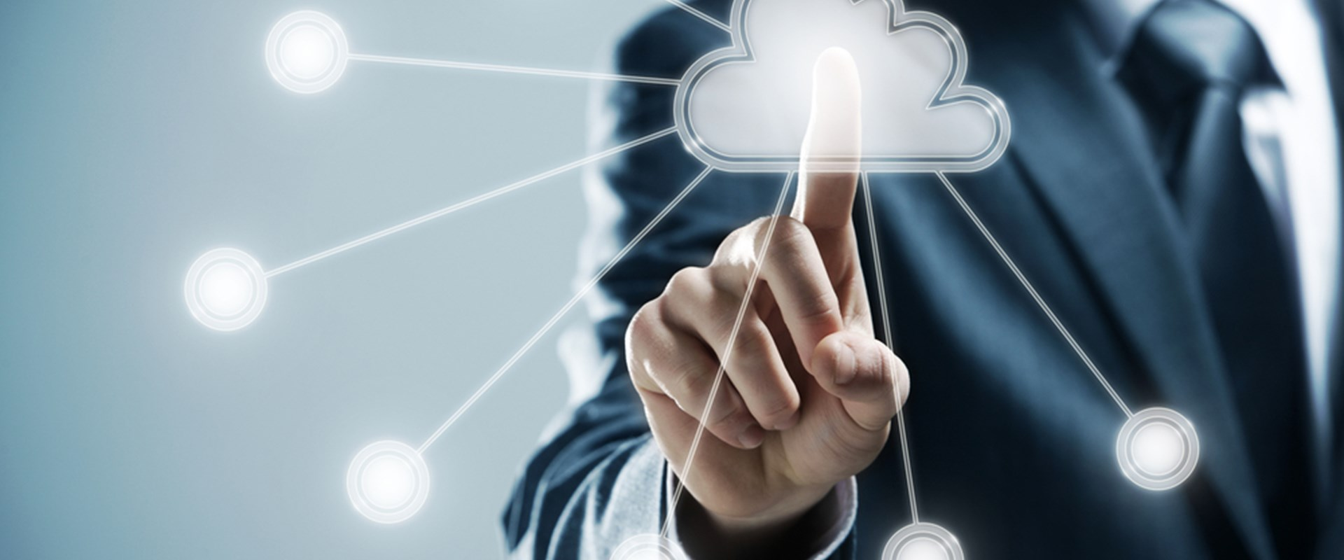 Business man pointing cloud computing